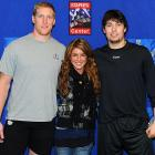 "Kings players Matt Greene (left) and Drew Doughty were paid a visit by ""90210"" star Shenae Grimes before Los Angeles' game against Calgary last Saturday."