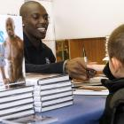 Terrell Owens showed his softer side while signing copies of his latest book and shaking hands with this kid at the Sports Museum of America in New York on Tuesday.