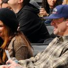Sandra Bullock and husband, Jesse James, attended Tuesday's Stars-Kings game.