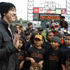 You'd think these kids, members of the Junior Giants, would've shown a little more excitement when celebrating Tim Lincecum's Cy Young Award win.