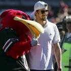 Michael Phelps took in last Saturday's Arkansas-South Carolina game, and even took a photo with Cocky.
