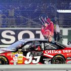 Carl Edwards flips off his car after winning the final race of the Chase. Edwards fell just 69 points short of wresting the Sprint Cup trophy away from Johnson. He led a race-high 157 laps, and won despite running out of gas as he crossed the finish line.