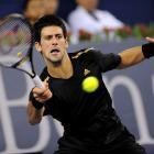 Djokovic plays Nikolay Davydenko in his second match of group play.