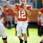 Colt McCoy passed for 300 yards and five touchdowns as the Longhorns bounced back from last week's loss to Texas Tech.
