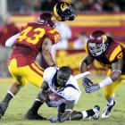 First California wide receiver Nyan Boateng lost his helmet, then his team lost the game.   Mark Sanchez passed for 238 yards and two touchdowns, and the USC defense held Cal to 165 total yards.