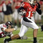 Nate Davis escapes a defender against Northern Illinois. The talented quarterback threw four touchdown passes and ran for another as Ball State stayed perfect.
