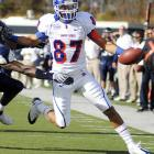 Austin Pettis hauled in nine catches for 126 yards and two TDs in Boise State's closer-than-expected 31-24 road win. Next up for the undefeated Broncos -- a date with Fresno State.