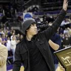 Cy Young winner Tim Lincecum waved to the University of Washington crowd after being honored at halftime of Thursday's game.