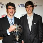 Giants quarterback Eli Manning helped Michael Phelps celebrate his win as ports Illustrated's 2008 Sportsman of the Year award on Tuesday at a party in NYC.