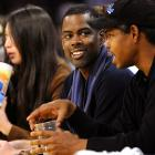 But funnyman Chris Rock managed to smile during the game.