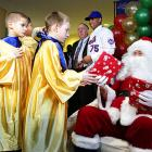 Mets pitcher Mike Pelfry played Santa Claus for some children at the Mets holiday party on Wednesday. Too bad the Mets didn't bring back Anna Benson for the event.