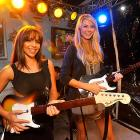"""Also on hand at the event were model Vida Guerra (left) and Stacy Keibler, who tried their hand at """"Guitar Hero."""""""