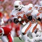 The Big Eight's leading rusher and scorer in 1985 and '87 and a two-time First Team All-America, Thomas was enshrined in the College Football Hall of Fame.