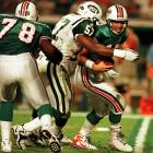 New York completed its rebuilding phase under Bill Parcells, scoring a late touchdown off a Dan Marino fumble to ultimately bring the Big Tuna his first AFC East title as Jets coach.