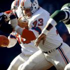 After posting a losing record in eight of their previous nine seasons, the '76 Patriots erupted for 2,957 rushing yards (then the fifth-highest total in NFL history), mostly on the legs of Steve Grogan and Sam Cunningham, with help from Hall of Fame guard John Hannah (pictured).