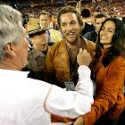 Matthew McConaughey and girlfriend Camila Alves congratulated Texas coach Mack Brown after the Longhorns beat Ohio State in the Fiesta Bowl.
