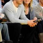 We'd like to believe Reese Witherspoon, shown here at last Sunday's Blazers-Lakers game, is making that face because she doesn't like Jake Gyllenhaal's hat.
