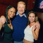 Lakers owner Jerry Buss relaxes with some Laker fans.