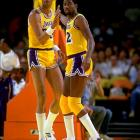 Magic Johnson and Kareem Abdul-Jabbar exchange a high five during a game against Portland.