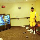 Kobe Bryant admires himself in the players' lounge prior to a game against Washington.