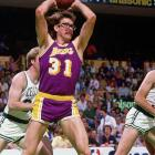 Former Laker forward and current assistant coach Kurt Rambis looks for an outlet pass during Game 1 of the NBA Finals.