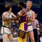 Magic Johnson and Danny Ainge argue while Larry Bird plays the role of peacemaker during a heated moment in the NBA Finals.
