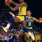 Magic Johnson glides past Dennis Johnson during a Celtics-Lakers regular season matchup.