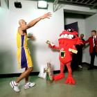 """Rick Fox gets ready to hug the """"Whammy"""" as he makes his way back to the locker room."""