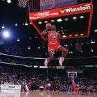 """In perhaps the NBA's best dunk contest, hometown favorite Jordan edged Dominique Wilkins 147-145 in the finals to become the first repeat winner. Needing a 48 on his final attempt to overtake Wilkins, Jordan scored a 50 after taking off just inside the free-throw line for a dunk. """"If it wasn't in Chicago, it might have gone the other way,"""" Jordan said afterward."""