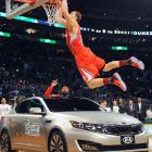 """In front of his hometown fans, Blake Griffin lived up to the hype and edged JaVale McGee to win the 2011 slam dunk title. Griffin's final and most impressive dunk of the night came when he jumped over a car and threw down a two-handed slam while a gospel choir sang """"I Believe I Can Fly"""" at halfcourt."""