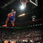 """The little man soared highest once again. Robinson would cap the night by donning a green uniform (complete with shoes and matching ball) to play the role of """"krypto-Nate"""" to defending champ Dwight Howard's Superman. He become the fifth two-time winner in the contest's history."""