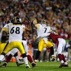 Ben Roethlisberger improvised and escaped the pass rush when possible. Other times he ditched the ball to avoid a sack. He ended up completing 21 of 30 passes for 256 yards, with one touchdown and one interception.
