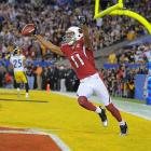 Larry Fitzgerald finished as the first player in NFL history with seven touchdown catches in a single postseason and the first to surpass 100 yards receiving in four consecutive playoff games.