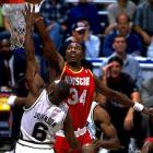 Houston's Hakeem Olajuwon rejects seven shots in the Rockets' 90-83 win over San Antonio, becoming the sixth player in NBA history to register 2,000 career blocks.