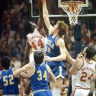 N.C. State's David Thompson lofts a shot over Bill Walton during the 1974 Final Four.