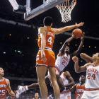 Indiana guard Keith Smart tries to squeeze a shot past Syracuse's Rony Seikaly during the Final Four championship in New Orleans. Indiana defeated Syracuse 74-73 for the title and Smart was named MVP for the tournament.