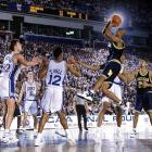 Michigan guard Jalen Rose shoots a jumper over Antonio Lang and his Duke teammates in Minneapolis. Duke defeated Michigan 71-51 to win the national title.