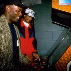 Hill and Dumars enjoy some downtime at a Detroit arcade.