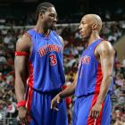 Wallace and Billups talk strategy during a playoff series against the 76ers.