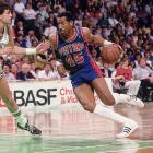 Dantley swoops past Kevin McHale during a game against the Celtics.