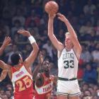 Boston's Larry Bird scores a franchise-record 60 points in a 126-115 victory over Atlanta.