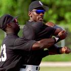 Jordan, pictured here stretching with Mike Cameron, was known in the clubhouse as being a tough customer in Ping-Pong and Yahtzee. ''He's a good guy and I think that he's gone out of his way to try and fit in,'' Barons shortstop Glenn DiSarcina told the  Atlanta Journal-Constitution . ''But he's still Michael Jordan. There are still guys in the clubhouse who don't know how to approach him.''