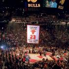 A year after Jordan first called it quits from the NBA, the Bulls retired his No. 23 jersey and unveiled his statue outside the United Center.