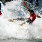Slater, in action at the 1994 U.S. Open of Surfing in Huntington Beach, Calif., dominated the sport in the mid-1990s.