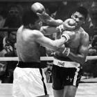 Muhammad Ali beats Jimmy Young in 15 to retain the heavyweight boxing title.