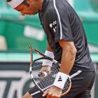 Fernando Gonzalez finds a way to break his racket in the most stoic way possible.
