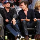 Kevin Bacon tries to get Leonardo DiCaprio's divided attention. Lakers first, then Kevin Bacon.