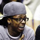 Lil Wayne engaged in some courtside banter at Game 4 of the Lakers-Rockets.
