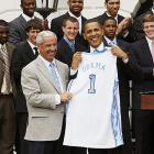 North Carolina coach Roy Williams presents President Barack Obama with a Tar Heels jersey during a ceremony honoring the 2008-2009 NCAA champions.