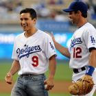 Slater, aka Mario Lopez, smiles with Brad Ausmus after throwing out the ceremonial first pitch before the game against the Mets on May 18, 2009.